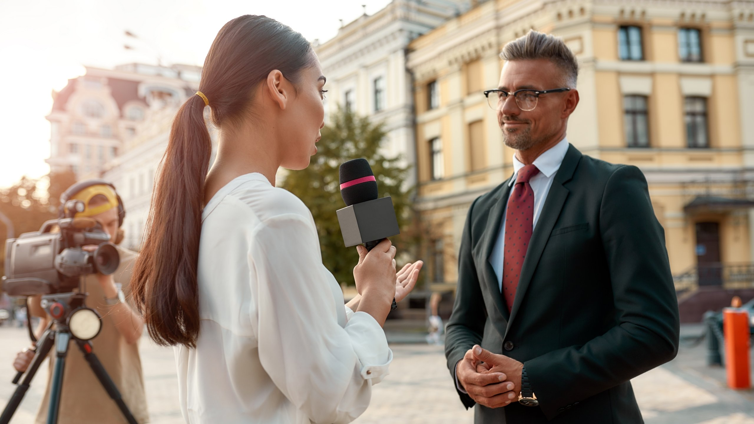 Lady interviewing business man