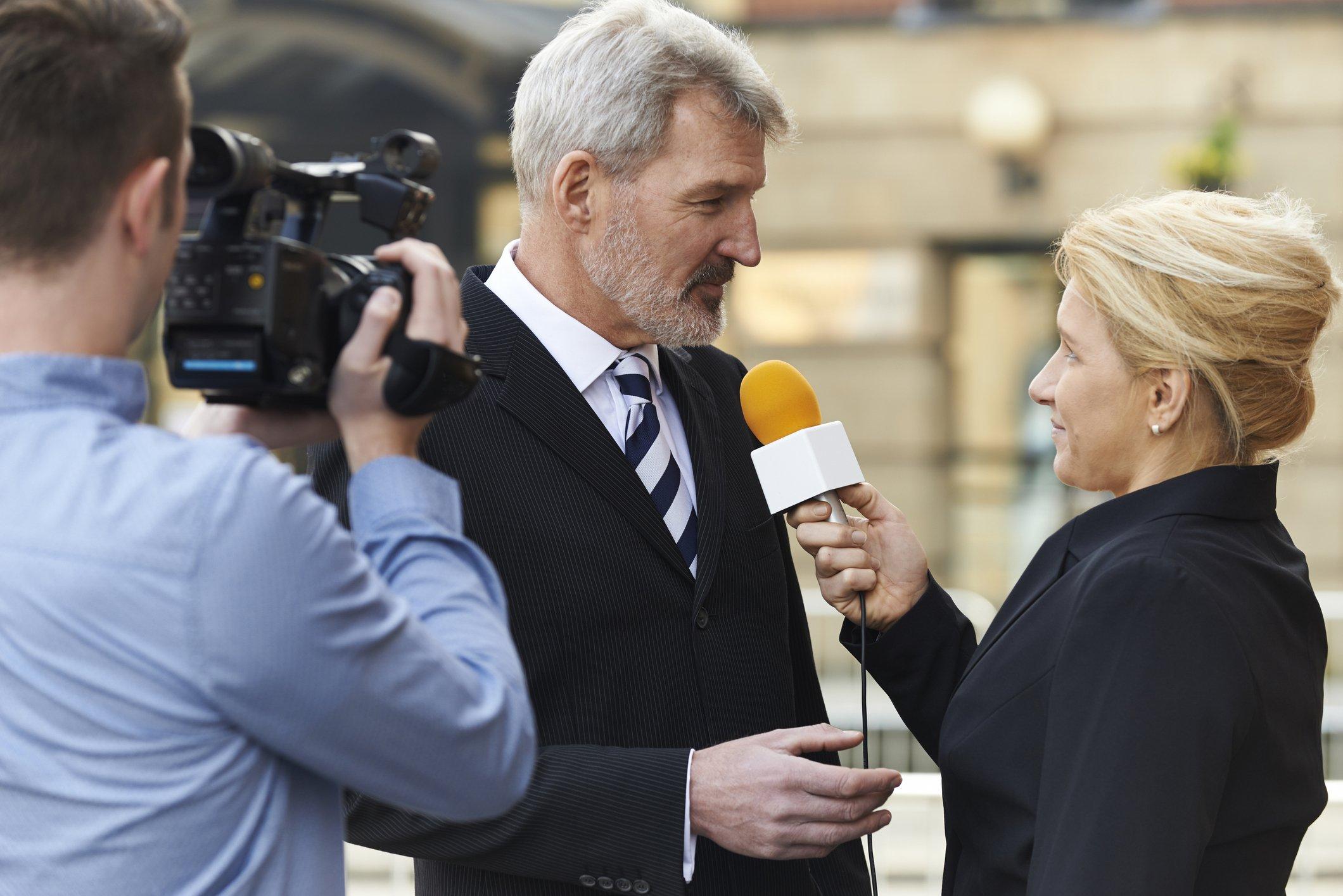 Journalist interviews businessman